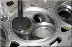 Chambered and machined cylinder head